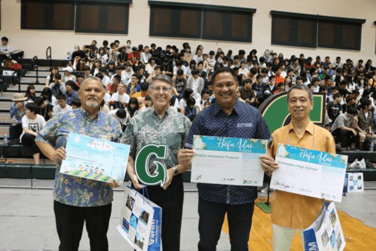 Guam Visitors Bureau (GVB) welcomed its newest Håfa Adai Pledge members University of Guam (UOG) Professional & International Programs (PIP), which included English Adventure Camp, Sports Adventure Camp, and students from the Wasegaku High School of Japan at a special ceremony held on June 19, 2019 at the UOG Calvo Fieldhouse. From left, UOG PIP Director Carlos R. Taitano; UOG President Thomas W. Krise; GVB Vice President Bobby Alvarez; and Wasegaku High School of Japan Chairman and Principal Tatsumi Moriya