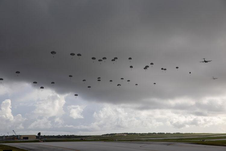 Hundreds of paratroopers of the 4th Infantry Brigade Combat Team (Airborne), 25th Infantry Division, U.S. Army Alaska, demonstrate a joint forcible entry into Andersen Air Force Base, Guam, June 29 after a direct flight from Joint Base Elmendorf-Richardson, Alaska.