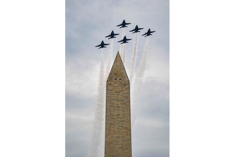 The U.S. Navy flight demonstration squadron, the Blue Angels, fly over the Washington Monument during a Fourth of July celebration in Washington, D.C., July 4, 2019. (IAN COTTER/U.S. NAVY)