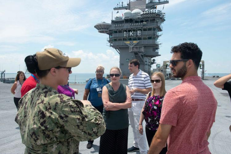 NORFOLK (June 27, 2019) Quartermaster 2nd Class Taylor Miller discusses flight deck operations to Department of the Navy civilians during a ship tour aboard Nimitz-class nuclear-powered aircraft carrier USS Dwight D. Eisenhower (CVN 69). (U.S. Navy photo by Mass Communication Specialist Seaman Dartez Williams/Released)