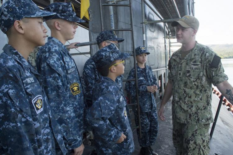 SANTA RITA, Guam (July 17, 2019) Chief Machinist's Mate (Auxilary) Jeramiah Andrew, a native of Cambridge City, Indiana, speaks to members of the U.S. Navy Sea Cadet Pacific Guam Program during a tour of USS Asheville (SSN 758). The purpose of the Sea Cadet program is promote interest and skill in naval disciplines while instilling strong moral character and life skills through leadership. (U.S. Navy photo by Lt. j.g. Meagan Morrison/Released)