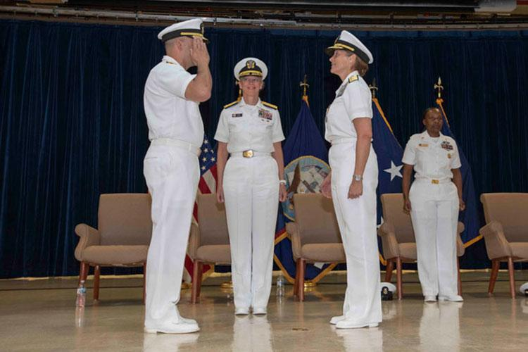 AGANA HEIGHTS, Guam (July 23, 2019) Rear Adm. John Menoni, left, assumes command of Joint Region Marianas from Rear Adm. Shoshana Chatfield during a change of command ceremony at the Guam High School gymnasium in Agana Heights July 23. Chatfield served as JRM commander from 2017 to 2019 and will report to the Naval War College in Newport, Rhode Island, where she will serve as president.