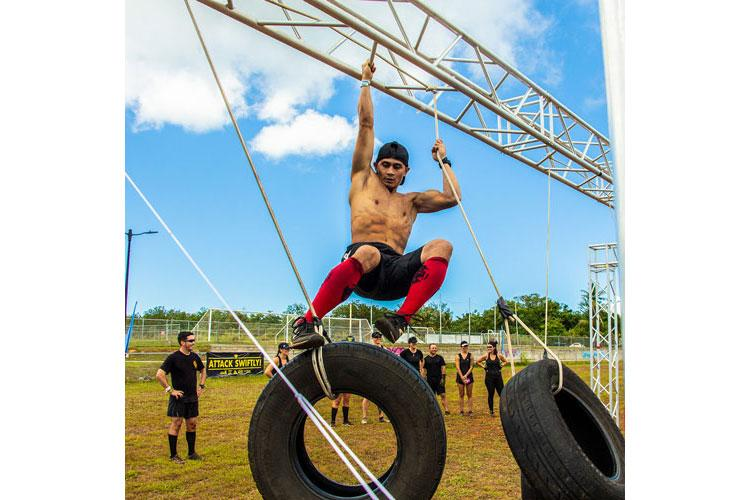 KONQER Enduro competitor Billy Navarette traverses the Monkey Kong obstacle during KONQER Guam's recent K11 Obstacle Course Challenge, as part of the 2019 Apocalypse Tour.