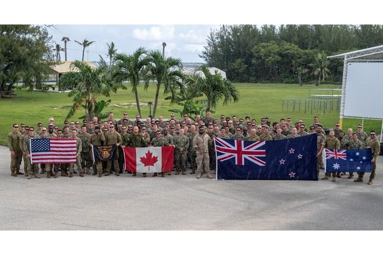 SANTA RITA, Guam (Aug. 30, 2019) Expeditionary forces from Australia, Canada, New Zealand and the United States pose for a group photo during Exercise HYDRACRAB. HYDRACRAB is a quadrilateral exercise conducted by forces from Australia, Canada, New Zealand, and U.S. Naval forces. (U.S. Navy photo by Mass Communication Specialist 2nd Class Kelsey L. Adams)