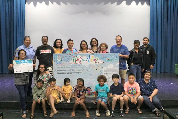 Guam Museum Executive Director, Dominica Tolentino, and Guam Museum Sales and Marketing Manager, Pauline Okada, aid in facilitating the Håfa Adai Pledge with the Guam Museum: Ha'anen Familia participants on September 14, 2019, alongside Guam Museum community partners.