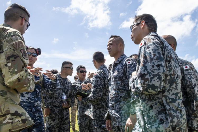 Members from the U.S. Air Force, U.S. Marine Corps, Japan Air Self-Defense Force, and the Royal Australian Air Force, discuss and exchange ideas after the the Agile Combat Employment exercise March 6, 2019, at Andersen Air Force Base, Guam. Elements of ACE are being incorporated into Pacific Air Forces-led exercises, and into those executed with allies and partners to demonstrate the strength of our combined nations. (U.S. Air Force photo by Master Sgt. JT May III)