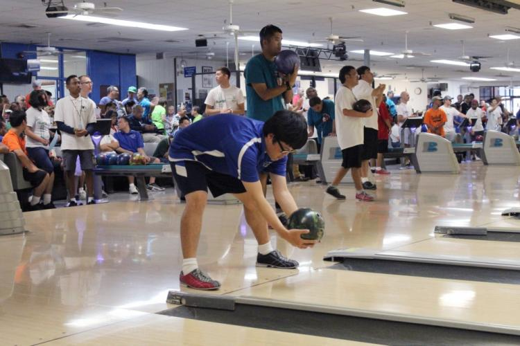 JOINT BASE PEARL HARBOR-HICKAM — Special Olympics Hawaii athlete Kyle Fukumitsu with the Kamali'i Koa team bowls his turn during the annual Holiday Classic at Hickam Bowling Center, Nov. 17. Special Olympics Hawaii held its event Nov. 17-18 at Joint Base Pearl Harbor-Hickam and Marine Corps Base Hawaii. (U.S. Navy photo by Kristen Wong, Oahu Publications)