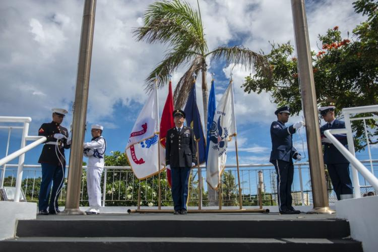 PITI, Guam (May 27, 2019) - Color guard members post the colors at half-mast during a Memorial Day ceremony at the Guam Veterans Cemetery in Piti May 27. During the ceremony, local and military residents honored the countless service members, who gave their lives in service to the nation. (U.S. Navy photo by Alana Chargualaf)