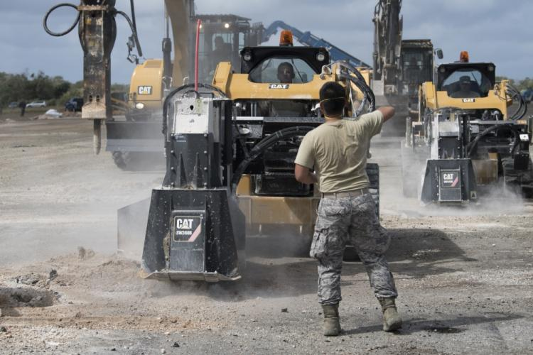 Students from Silver Flag class 19-05 use asphalt cutters to isolate damged areas of a runway, as part of a rapid airfield damage repair exercise, March 7, 2019, on Andersen Air Force Base Guam. This exercise marked the first time that a full scale airfield assessment, clearance and repair took place in the same exercise. (U.S. Air Force photo by Senior Airman Zachary Bumpus)