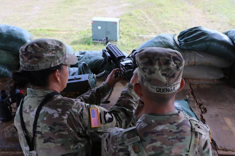 Sgt. Gloria Babauta (left) demonstrates to one of her Soldiers how to properly clear a M249 as she conducts one of her many duties on February 4, 2019 at the Terminal High Altitude Area Defense site in Yigo, Guam. Babauta is team leader and part of her duties is to ensure her Soldiers are knowledgeable on their equipment. (U.S. Army photo by Sgt. Malcolm Cohens-Ashley)