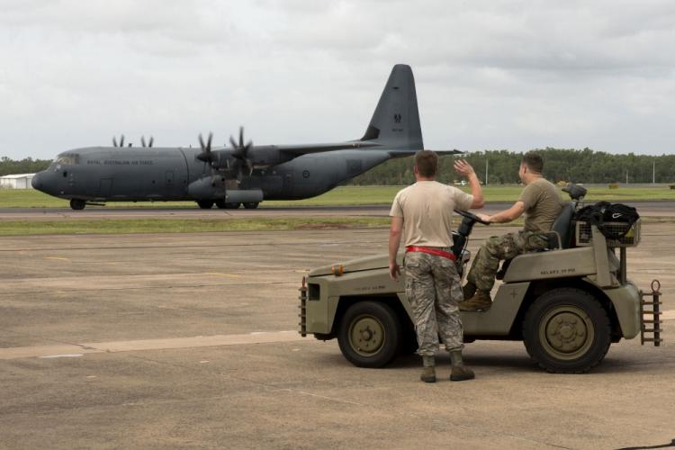 U.S. Airmen assigned to the 5th Maintenance Group wave at a passing Royal Australian Air Force (RAAF) C-130 Hercules during Diamond Shield 2019 (DS-19) at RAAF Base Darwin, Australia, March 26, 2019. By regularly exercising their combined capabilities, members of the U.S. Air Force and RAAF are better prepared to respond to disaster events in the Pacific region. (U.S. Air Force photo by Staff Sgt. Zade Vadnais)