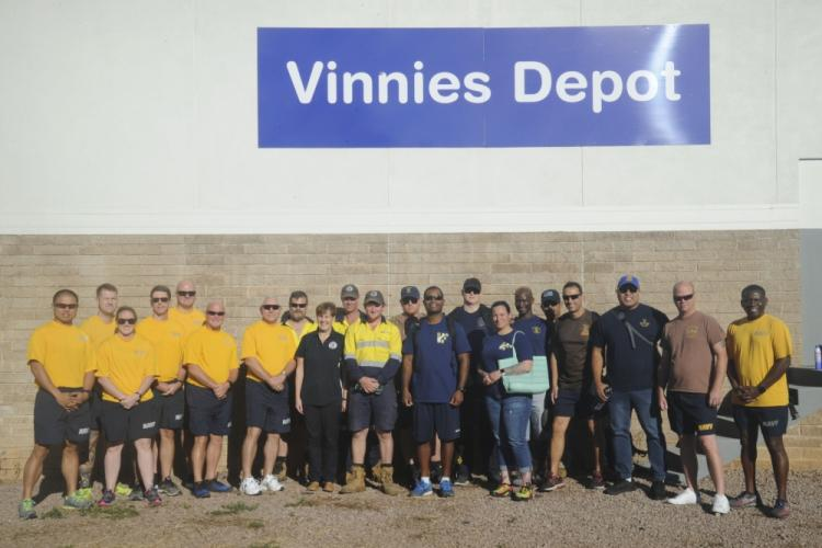 DARWIN, Australia (August 29, 2019) - Sailors assigned to the submarine tender USS Emory S. Land (AS 39) pose for a photo outside of Vinnies Depot during a community relations event, Aug. 29. Land is deployed to the U.S. 7th Fleet area of operations to support theater security cooperation efforts in the Indo-Pacific region. (U.S. Navy photo by Mass Communication Specialist 2nd Class Jordyn Diomede/Released)