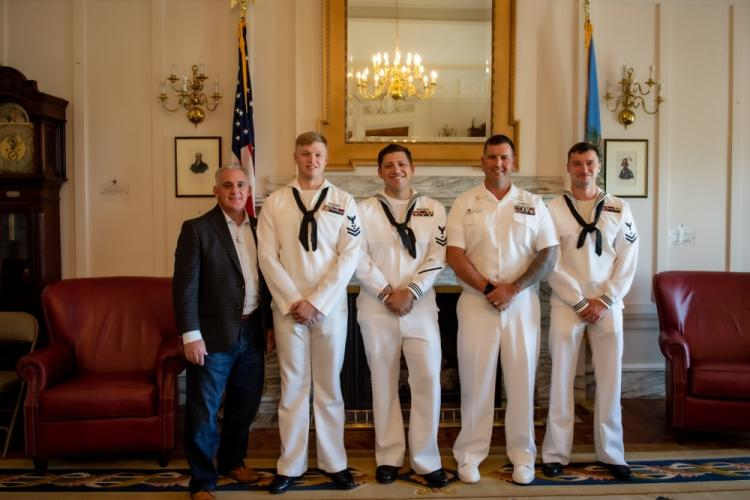 OKLAHOMA CITY, OK (May 31, 2019) Senator Paul J. Rosino of Senate District 45 and retired Master Chief, takes a photo with Sailors assigned to the Los Angeles-class submarine USS Oklahoma City (SSN 723) during a tour of the state capitol. (U.S. Navy Photo by Mass Communication Specialist 2nd Class Allen Michael McNair)