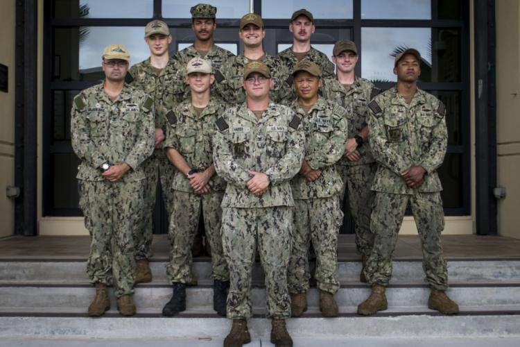 SANTA RITA, Guam (July12, 2019) Sailors from Commander, Submarine Squadron Fifteen pose for a photo after completing a community relations volunteer event. The Sailors and staff at Guahan Charter Academy School spent more than 20 hours rebuilding flooring, painting classrooms, and cleaning the school grounds. (U.S. Navy photo by Mass Communication Specialist 2nd Class Kelsey Hockenberger/Released)
