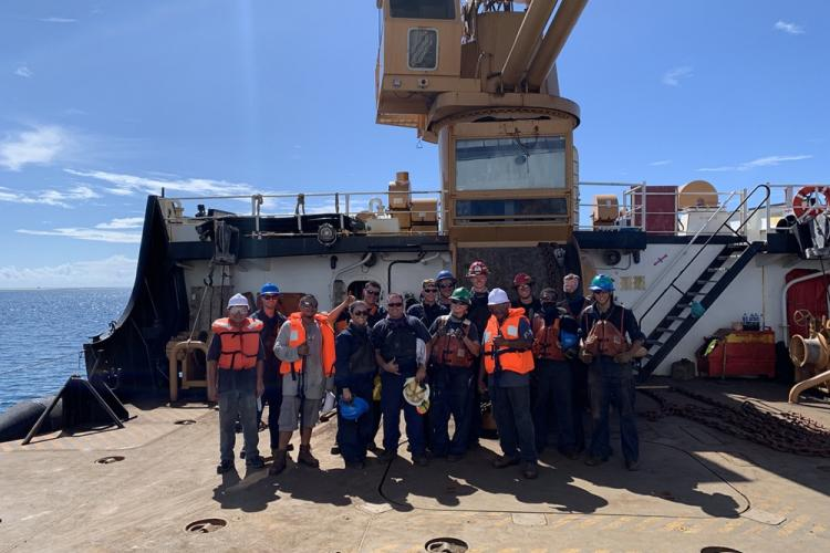 Members of Coast Guard Cutter Sequoia (WLB 215) stand for a photo with representatives of the Palau Ministry of Transportation May 5, 2019, off Palau. The Sequoia crew set four buoys in the waterway of the Port of Koror at the request of the U.S. Embassy in Koror. (U.S. Coast Guard photo by USCGC Sequoia/Released)