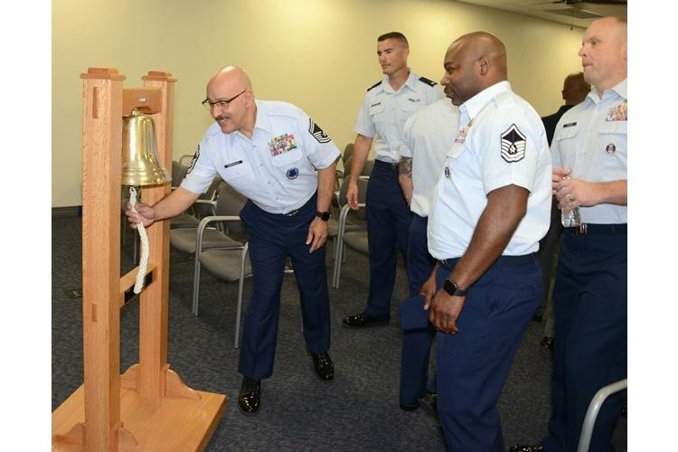 Senior Master Sgt. Randy Rodriguez, Air Force Recruiting Total Force Recruiting Cell superintendent, Joint Base San Antonio-Randolph, Texas, rings the bell signifying Air Force Recruiting Service reached its yearly goal. Each person at AFRS headquarters gets a turn at ringing the bell to celebrate making goal. (U.S. Air Force photo by Master Sgt. Chance Babin)