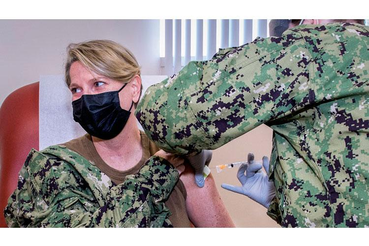 Navy Rear Adm. Anne Swap, National Capital Region director, receives her annual influenza vaccine at the Fort Belvoir Community Hospital. She accompanied Army Lt. Gen. Ronald Place, director of the Defense Health Agency, to the facility as he, too, received his annual flu shot.