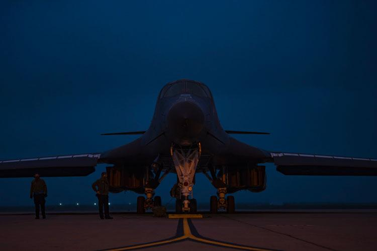 Airman 1st Class Andrew Thomas, 7th Aircraft Maintenance Squadron crew chief, left, and Staff Sgt. Eric Kosecki, 7th AMXS crew chief, prepare to do preflight inspections on a B-1B Lancer at Dyess Air Force Base, Texas, Oct. 19, 2020. Airmen assigned to the 7th Bomb Wing deployed in support of a Bomber Task Force operation in Andersen AFB, Guam. (U.S. Air Force photo by Airman 1st Class Colin Hollowell)