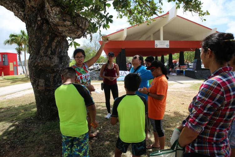 TUMON, Guam (April 6, 2019) - Eco Fair goers participate in a mini nature walk for education on the native and invasive species found in the local environment at the Guam Nature Alliance Earth Month Kickoff Eco Fair at Ypao Beach on April 6th, 2019. (U.S. Marine Corps photo by Kelly Rodriguez)
