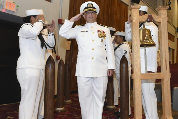(May 30, 2019) SANTA RITA, Guam - Capt. Tadd Gorman salute the side boys during the USS Antietam change of command ceremony at the big screen theater at U.S. Naval Base Guam. Capt. Tadd Gorman relieved Capt. George A. Kessler as the ship's Commanding Officer of the Ticonderoga-class guided missile cruiser. Antietam is forward deployed to the U.S. 7th Fleet area of operation in support of security and stability in the Indo-Pacific region. (Photo by Mass Communication Specialist 1st Class Toni Burton)