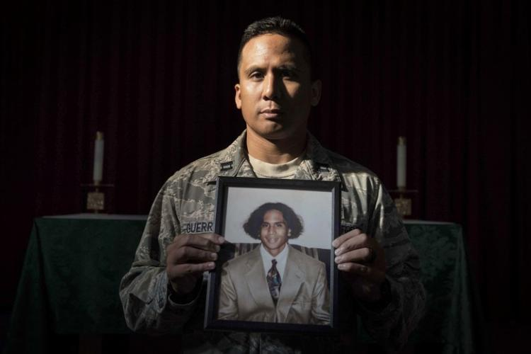 U.S. Air Force Capt. Genesis Guerrero, a 39th Air Base Wing chaplain, holds his high school portrait at Incirlik Air Base, Turkey, Oct. 2, 2019. When he was 17 years old, Guerrero used the picture to successfully dissuade his father from committing suicide. (U.S. Air Force photo by Staff. Sgt. Joshua Magbanua)