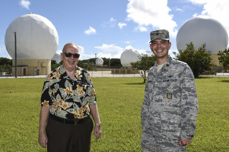 Joel E. Chalmers (left), Detachment 2, 21st Space Operations Squadron station manager and Major Joel N. Chalmers, 36th Wing Inspector General director of inspections, pose for a photo on Northwest Field, Andersen Air Force Base, Guam, Oct. 2, 2019. Joel E. and Joel N. are father and son. Major Chalmers was inspired to pursue space operations from seeing his dad work in space operations on AAFB growing up. (U.S. Air Force photo by Airman 1st Class Michael S. Murphy)