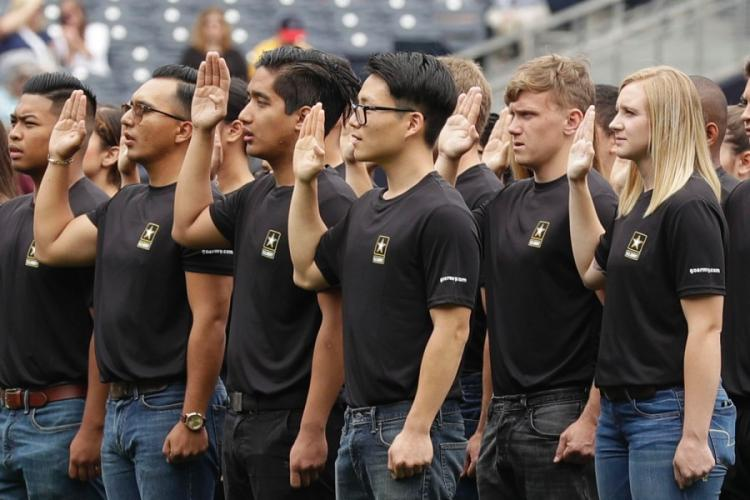 New Army recruits take part in a swearing-in ceremony before a baseball game between the San Diego Padres and the Colorado Rockies in San Diego. A year after failing to meet its enlistment goal for the first time in 13 years, the U.S. Army is now on track to meet a lower 2019 target after revamping its recruitment effort. GREGORY BULL/AP