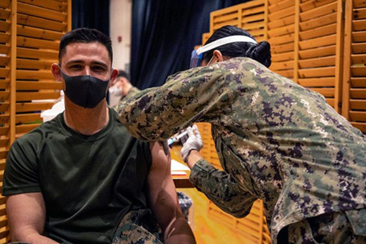 Marines with the 3rd Marine Expeditionary Brigade receive the Moderna COVID-19 vaccination shot on Camp Hansen, Okinawa, Japan on Jan. 20. Receiving the vaccine mitigates risks to military operations, allowing Marines to maintain their readiness and be able to respond to any crisis or contingency in the Indo-Pacific region. (Photo by Marine Cpl. Sarah Marshall, 3rd Marine Expeditionary Brigade.)