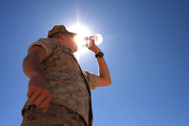 A Marine drinks water at Twentynine Palms, Calif. Heat-related illnesses increased among troops during the past five years, and young Marines and soldiers based in the southeastern U.S. were most at risk, according to a new military medical report. U.S. MARINE CORPS