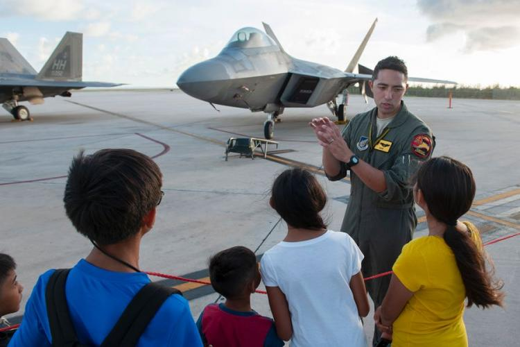 A pilot answers questions about the F-22 Raptor at the Francisco C. Ada International Airport, Saipan, during exercise Resilient Typhoon, April 23, 2019. JOHN LINZMEIER/U.S. AIR FORCE