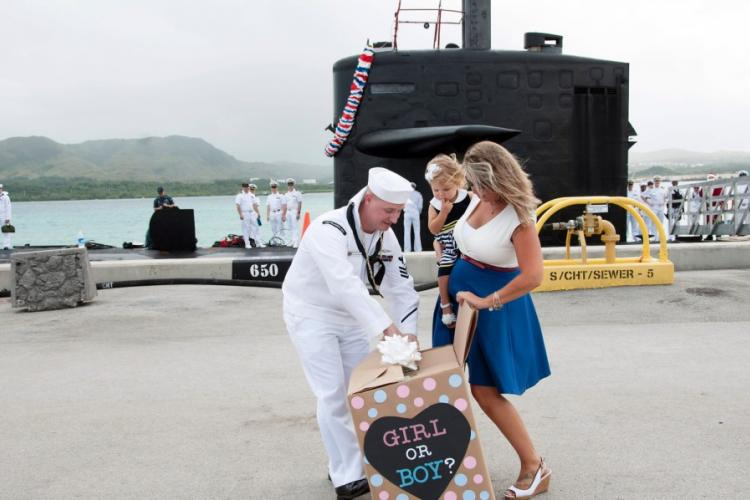 Jennifer Atkins gives a baby gender reveal to her husband, Petty Officer 1st Class Jonathan Atkins, on the pier at Apra Harbor, Guam, during a homecoming celebration for the submarine USS Oklahoma City in December 2016. Two recent studies differ on whether men on submarines father girls significantly more often than they do boys. JAMICA JOHNSON/U.S. NAVY