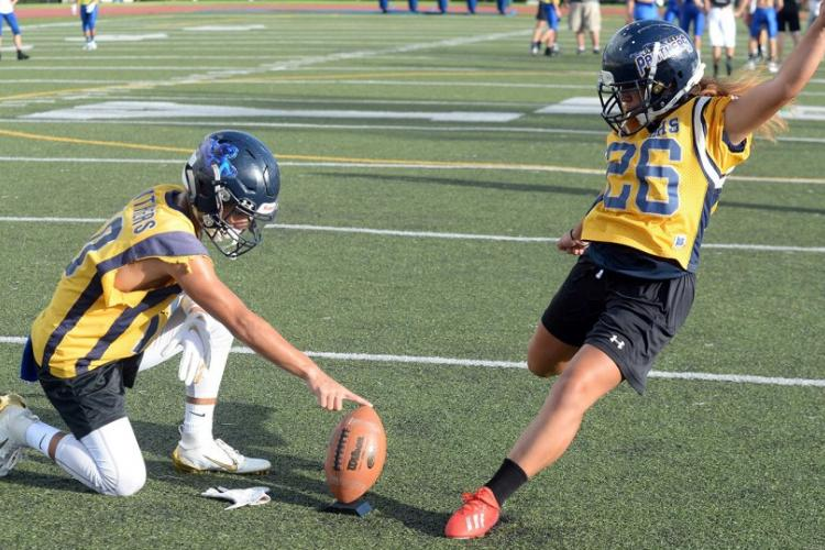 Ali Shimasaki, right, gives Guam High an edge on special teams. DAVE ORNAUER/STARS AND STRIPES