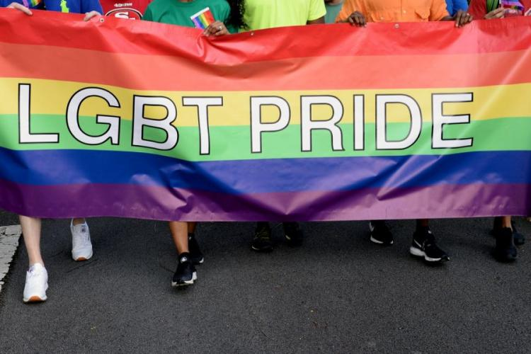Sailors march in a Lesbian, Gay, Bisexual and Transgender Pride Walk in 2017. The Navy says transgender sailors can dress in their preferred clothing while off duty. MARC AYALIN/U.S. NAVY