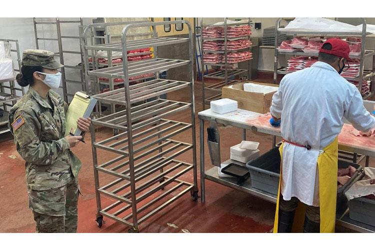 U.S Army Spc. Regina Shillingburg, Public Health Activity-Guam veterinary food inspection specialist, conducts a food inspection of the meat department at Orote commissary, Naval Base Guam, April 2020. To help keep the military community safe from COVID-19 and foodborne illness, PHA-Guam Soldiers assist Navy preventive medicine by inspecting approximately 40 facilities on base, including the commissary, Navy Exchange food court, shoppettes, galleys, and restaurants. (Courtesy Photo)