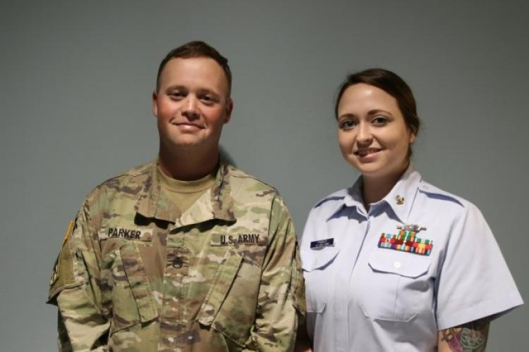 U.S. Army Staff Sgt. Nicholas Parker and his wife, U.S. Coast Guard Petty Officer Second Class Andrea Parker smile for a photo on February 4, 2019, at Andersen Air Force Base, Guam. (Photo Credit: Sgt. Malcolm Cohens-Ashley)