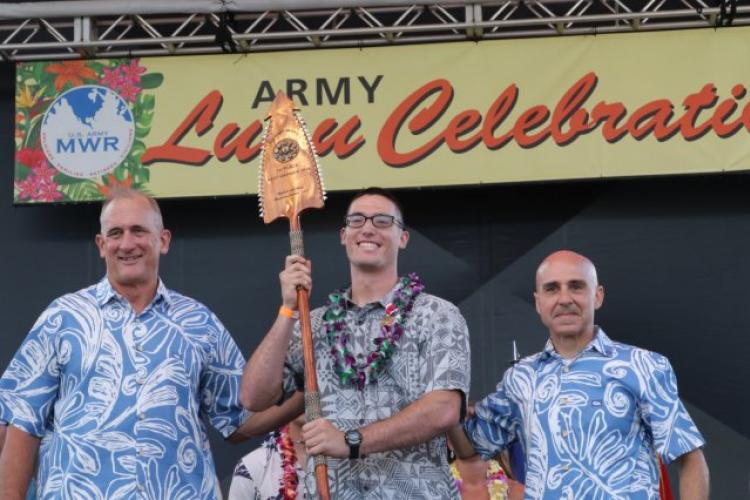 Gen. Robert Brown (left), the commanding general of U.S. Army Pacific and Command Sgt. Maj. Benjamin Jones, the command sergeant major of U.S. Army Pacific (right), present Spc. Alexander Vandermark (middle) with a spear for winning the U.S. Army Pacific Best Warrior Competition, Soldier of the year on June 14, 2019, at Weyland Field, Schofield Barracks, Hawaii. (Photo Credit: Sgt. Malcolm Cohens-Ashley)