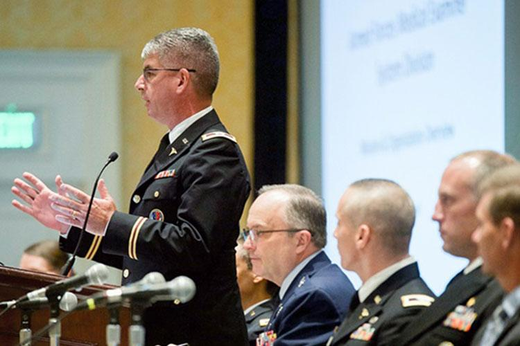 Army Col. Louis Finelli of the Armed Forces Medical Examiner System speaks at a panel discussion during the 2019 Military Health System Research Symposium. (Photo by: MHS)