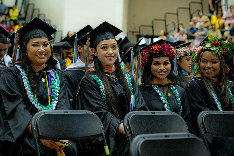 Graduates from UOG's Professional Master of Business Administration program at commencement in December. (From left) Ione Skye Llagas, Nicole Mesa, Erica Pangelinan, and Aubreeana Taylor. Photos courtesy of the University of Guam