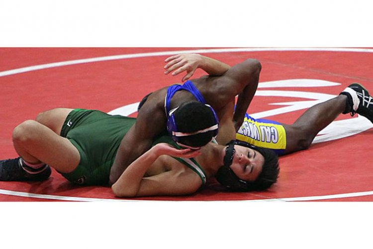 """Christian Academy Japan's Jordan Van Druff gains the edge on Kubasaki's Noah Vasquez en route to victory in the 108-pound final of Saturday's Nile C. Kinnick Invitational """"Beast of the Far East"""" wrestling tournament.  SHEILA SUCKART/SPECIAL TO STRIPES"""
