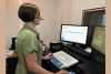 Hearing Center of Excellence audiologist Dr. Amy Boudin-George conducts an audiogram using the Enterprise Clinical Audiology Application, known as ECCA, which is being deployed and implemented at military treatment facilities throughout the Department of Defense to improve the way data is computed and patient information is shared in a centralized environment. (DoD photo)