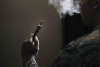 An Airman holds an electronic cigarette at Scott Air Force Base, Illinois. The Centers for Disease Control and Prevention is investigating the more than 2,000 cases of e-cigarette, or vaping, product use associated lung injury that have occurred across the country. (U.S. Air Force photo by Airman 1st Class Erica Crossen)