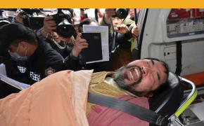 A suspect, identified by police as 55-year-old Kim Ki-jong, is carried on a stretcher off an ambulance as he arrives at a hospital in Seoul, South Korea, on Thursday, March 5, 2015. U.S. Ambassador Mark Lippert was in stable condition after the man screaming demands for a unified North and South Korea slashed him on the face and wrist with a knife, South Korean police and U.S. officials said. (Han Jong-chan, Yonhap/AP)