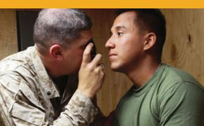 Cmdr. Keith Stuessi, a family physician with the Concussion Restoration Care Center, examines Sgt. Gorge Segura at Camp Leatherneck, Afghanistan, Aug. 26, 2010. Segura suffered a grade-two concussion when a 100-pound roadside bomb exploded 30 meters away from him during a foot patrol in the Kajaki region of northern Helmand Province. (U.S. Marines)