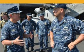 """Adm. Harry Harris Jr., left, commander of U.S. Pacific Fleet, speaks with Capt. John Menoni, commander of USS San Diego, during a ship visit in February 2015 at Pearl Harbor, Hawaii. Harris told a naval conference in Australia that competing territorial claims by several nations in the South China Sea are """"increasing regional tensions and the potential for miscalculation."""" (Amanda Dunford/Courtesy U.S. Navy)"""