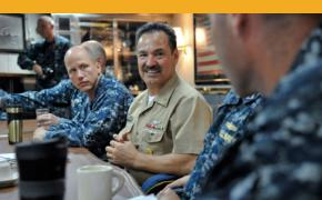In this photo taken Aug. 18, 2013, U.S. Pacific Fleet Master Chief Marco Ramirez talks with officers and midshipmen in the wardroom on board USS Paul Hamilton during a round-table discussion. (Amanda Dunford/U.S. Navy)