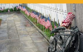 Members of The Old Guard looks more flags and more empty headstones toward the end of the Flags-In at Arlington National Cemetery on May 21, 2015, inside the columbarium. (Meredith Tibbetts/Stars and Stripes)