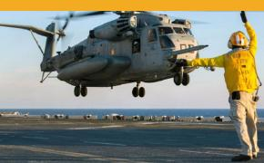 A U.S. sailor directs the landing of a CH-53E Super Stallion helicopter on the flight deck of the amphibious assault ship USS Kearsarge on Sept. 22, 2014. During an all-hands call aboard the ship at Naval Station Norfolk, Va., on Wednesday, Oct. 22, 2014, Chief of Naval Operations Adm. Jonathan Greenert told the crew that eight-month deployments are no longer sustainable. (Tamara Vaughn/U.S. Navy)