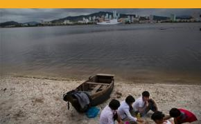 "In this June 21, 2014 photo, a group of young North Koreans enjoys a picnic on the beach in Wonsan, North Korea. The Associated Press was granted permission to embark on a weeklong road trip across North Korea to the country's spiritual summit Mount Paektu. The trip was on North Korea's terms. AP reporter and photographer couldn't interview ordinary people or wander off course, and government ""minders"" accompanied them the entire way. (David Guttenfelder/AP)"