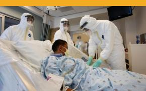 In this photo provided by the UCLA Health System, doctors and staff participate in a preparedness exercise on diagnosing and treating patients with Ebola virus symptoms, at the Ronald Reagan UCLA Medical Center in Los Angeles.   Reed Hutchinson/UCLA Health System