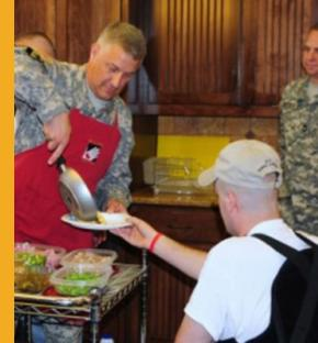 Photos such as this one from Army.mil are copied and used in online false identity scams. Here, Sgt. Maj. of the Army Raymond Chandler serves up an omelet he just made to a wounded warrior at Fort Sam Houston in Texas in 2011. Photos of senior Army leaders are so popular that the Army's public affairs office monitors misuse. (Torres Cortes/Courtesy of the U.S. Army)